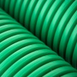 Green plastic pipes - Foto Stock