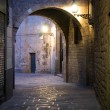 Narrow street in Barcelona - Stock Photo