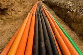 Plastic pipes with cables — Stock Photo