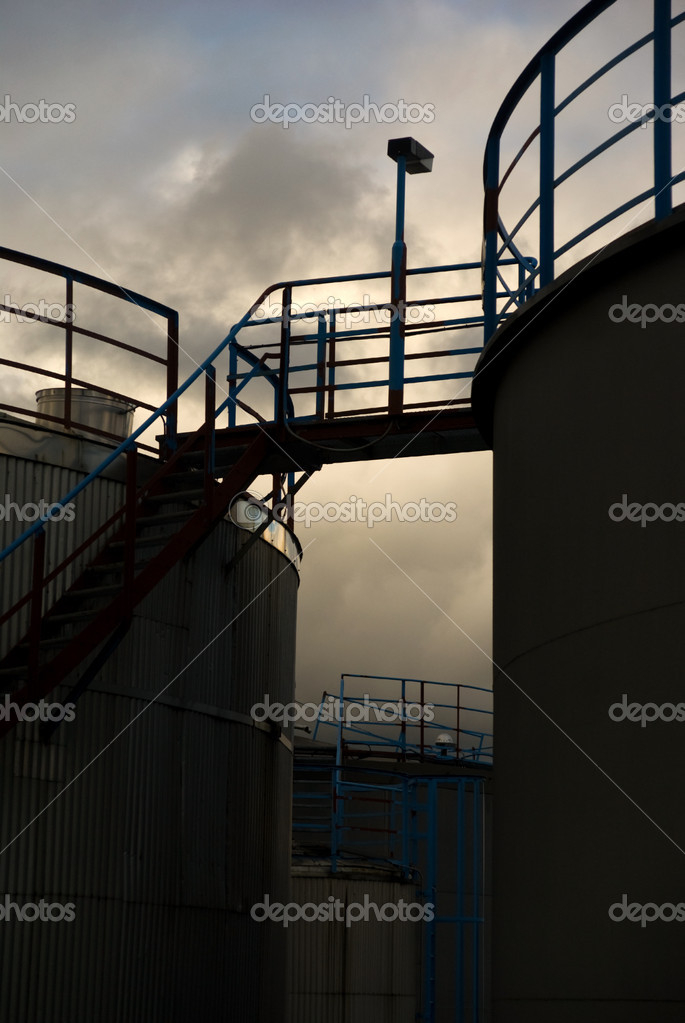 Silhouette of storage tanks for oil or gas  Stock Photo #7215136