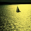 Sailing boat at sunset — Stock Photo