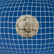 Stock Photo: Soccer net with ball