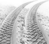 Tire tracks in snow — Stock Photo