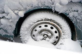 Wheel in snow — Stock Photo