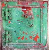 Stained green metal door — Stock Photo