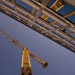 Reflection of a crane in an office building - Stock Photo