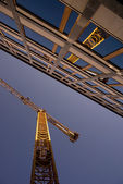 Reflection of a crane in an office building — Stockfoto