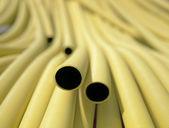 Yellow plastic pipes — Stock Photo