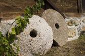 Ancient millstones — Stock Photo