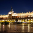 Night view of Krakow's market Place and Cloth Hall - Stock Photo