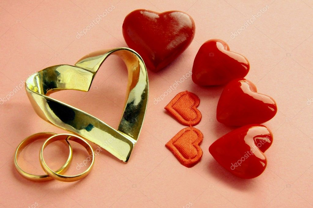 gold and red symbols of love and marriage � stock photo