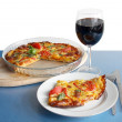 Pizza and glass of red wine as tasty italian lunch — Stock Photo