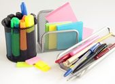 Pens,pencils,markers and papers in office — Stock Photo