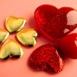 Red and gold hearts as symbols of love and kindness - Stock Photo