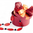 Red round box with necklace as gift — Stock Photo