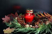 Cemetery and tomb decorated of red candle and wreath — Stockfoto