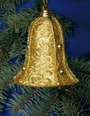 Golden textile bell as christmas tree decoration — Stok fotoğraf