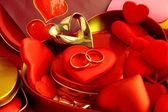 Jewellery and red hearts — Stock Photo