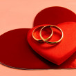 Wedding gold rings and heart as symbol of love and marriage — Stock Photo