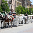 Traditional cabs with horses in Krakow - Stock Photo
