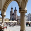 Mary's Church and market Place in Krakow - Stock Photo