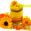 Marigold petals and herbal tea as natural medicine - Stock Photo