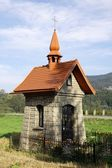 Small stony chapel in Polish village — Stok fotoğraf