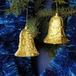 Stock Photo: Golden bells on Christmas tree