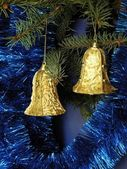 Golden bells on Christmas tree — Стоковое фото