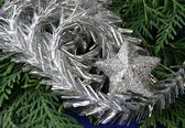 Silver decoration for Christmas on coniferous tree — Stok fotoğraf