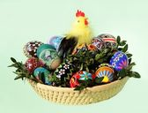 Easter eggs and yellow cock as traditional decoration — Stock Photo