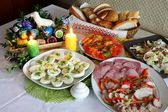 Easter decorated table with food — Stock Photo