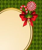 Christmas background with bow and candy. — Stock Photo