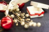 Christmas still life with decorations on a black background — Stock Photo