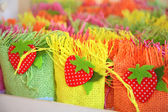 Small color baskets with sugar candys — Stock Photo