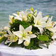 Wedding bouquet of flowers by the sea — Stock Photo