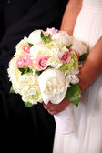 Bride holding a bouquet — Stock Photo