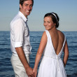 Bride and groom at the beach — Stock Photo #7395842