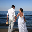 Bride and groom at the beach — Stock Photo
