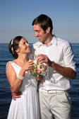 Bride and groom at the beach — Stok fotoğraf