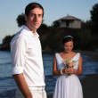 Bride and groom at the beach — Stock Photo #7591791