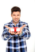 Man holding a gift — Stock Photo