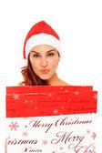 Santa claus girl holding a shopping bag — Stock Photo