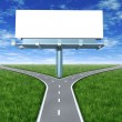 Stock Photo: Cross roads with billboard