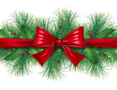 Red bow with pine border — Stock Photo