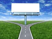 Cross roads with billboard — Stock Photo