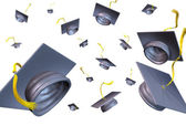 Graduation hats thrown in the air — Stock Photo