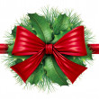 Foto Stock: Red bow with pine border and circular decoration