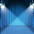 Spotlights on blue velvet cinema curtains — Stock Photo #7854543