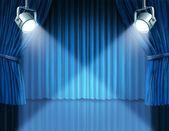 Spotlights on blue velvet cinema curtains — Stock Photo